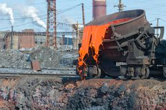 The molten slag is poured from a cup. On a railway platform Royalty Free Stock Photo