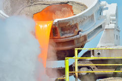 The molten slag is poured from a cup Stock Photos
