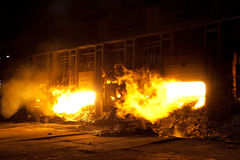 Molten steel in blast furnace. Bright glow of molten steel in a blast furnace Royalty Free Stock Photography