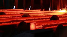 Steel mill at work. Molten steel casting and rolled steel production at metallurgical works stock footage