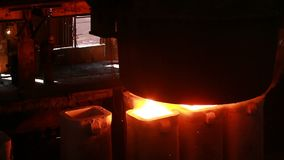 Steel mill at work. Molten steel casting and rolled steel production at metallurgical works stock video footage