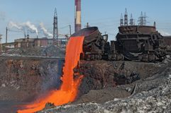 The molten steel is poured into the slag dump. Royalty Free Stock Image