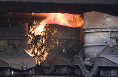 Molten steel pouring Stock Photos