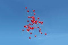 Molti aerostati di colore rosso Fotografia Stock Libera da Diritti