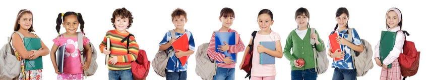 Molti allievi dei bambini che ritornano al banco Immagini Stock Libere da Diritti
