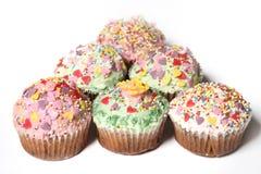 Molti bigné o piccole torte Fotografie Stock
