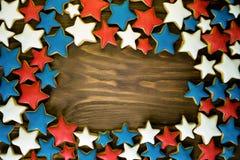 Molti biscotti dello zenzero di forma della stella Fotografie Stock