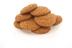 Molti biscotti su un piatto bianco Immagini Stock