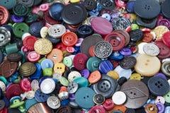Molti bottoni di vari forme e colori Fotografia Stock