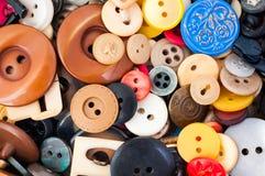 Molti bottoni graduati ed a forma di differenti Fotografie Stock