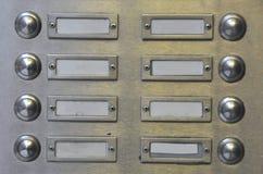 Molti campanelli per porte nelle righe Fotografie Stock Libere da Diritti