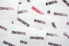 Molti confidenziali timbrati su Libro Bianco Fotografie Stock Libere da Diritti