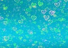Molti cuori brillanti su fondo blu Fotografie Stock