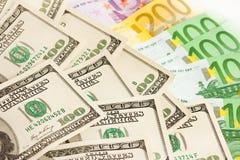 Molti euro e dollari Fotografie Stock