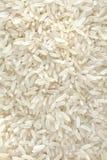Molti granuli di riso bianco Immagine Stock