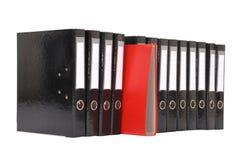 Molti i grandi dispositivi di piegatura neri su una priorità bassa bianca Fotografie Stock Libere da Diritti