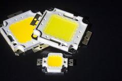 Molti LED intestati da un 10V potente sono nel concetto del mucchio di energia di risparmio, i soldi di risparmio, il primo piano Fotografia Stock Libera da Diritti