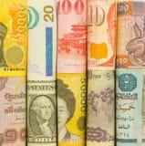 Molti rotolano la valuta dai molti paese Immagini Stock Libere da Diritti