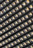 Molto piccola lampada di giallo LED in una fila Fotografia Stock Libera da Diritti