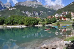 Molveno, Italy. Molveno is located in Italy, Europe.  Images shows Molveno and Molveno Lake in the front, silent water with small waves in the middle and Royalty Free Stock Image
