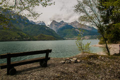 Molveno lake with bench Royalty Free Stock Images