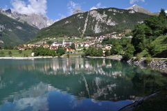 Molveno with lake, Italy. Molveno is located in Italy, Europe.  Images shows Molveno and Molveno Lake in the front, silent water with small waves in the middle Royalty Free Stock Photography