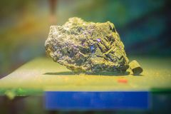 Molybdenite rock specimen from mining and quarrying industries. Royalty Free Stock Photos