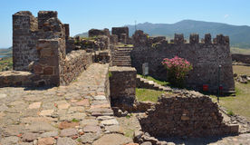 Molyvos Castle inner fortifications. Molyvos, Lesvos, Greece - June 12, 2014: Molyvos Castle sites at the top of the hill overlooking the town. The photo shows royalty free stock photo