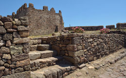 Molyvos Castle inner fortifications. Molyvos, Lesvos, Greece - June 12, 2014: Molyvos Castle sites at the top of the hill overlooking the town. The photo shows royalty free stock image