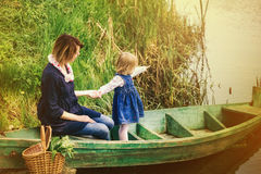 Mom and adorable small daughter playing together in old wooden b Royalty Free Stock Images