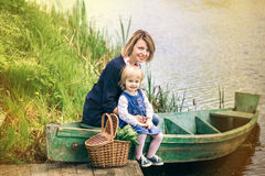 Mom and adorable small daughter playing together in old wooden b Stock Photography
