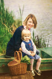 Mom and adorable small daughter playing together in old wooden b Royalty Free Stock Photos