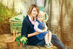 Mom and adorable small daughter playing together in old wooden b Stock Photo