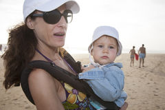 Mom And Baby In Rucksack At Beach Royalty Free Stock Photography