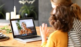Free Mom And Child Making Talking With Grandma Through Video Call On Laptop Stock Image - 216720321