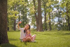 Free Mom And Daughter Are Talking On The Phone Close-up And Copy Space. The Sisters Make Video Calls By Phone In The Park. Mother`s Day Royalty Free Stock Images - 194609879