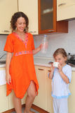 Mom And Daughter Standing In Kitchen Royalty Free Stock Photos