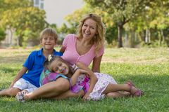 Mom And Her Children In The Park Stock Photo