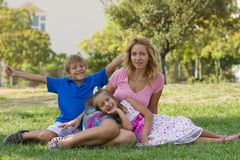 Mom And Her Children In The Park Royalty Free Stock Images