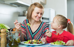 Free Mom And Kid Eating Vegetable Salad Stock Photography - 93289562