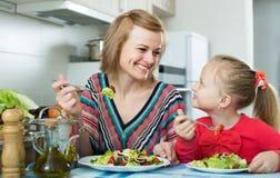 Mom And Kid Eating Vegetable Salad Stock Photography