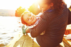 Mom And Son Having Fun By The Lake Royalty Free Stock Photos