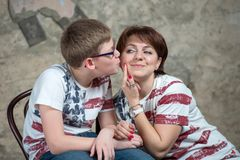 Mom asks to kiss. Warm regards mom and son Royalty Free Stock Photo