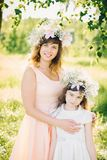 Mom with an attractive smile hugging her daughter in the Park in the summer Royalty Free Stock Image