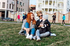 Mom and aunt play with a boy in the Park. Beautiful happy family resting in nature. Two women - mom and aunt play with a boy Stock Photography