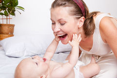 Mom and baby Stock Images