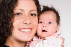 Mom and baby. Happy mom holding her baby and smiling Stock Photos