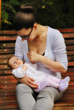 Mom and baby. Mom and newborn baby in nature Stock Image