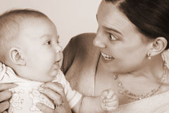 Mom and Baby. Smiling Mother and Baby on a white background stock images