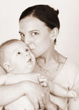 Mom and Baby. Smiling Mother and Baby on a white background stock photos
